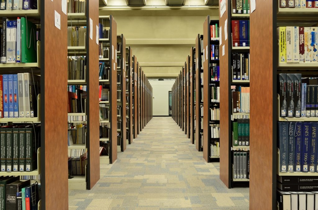 Bookshelves on library hall